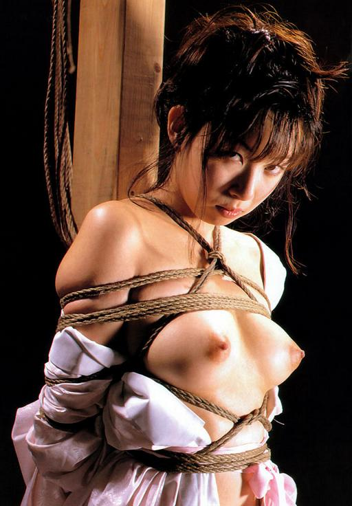 bondage girl pouting and showing her pretty tits