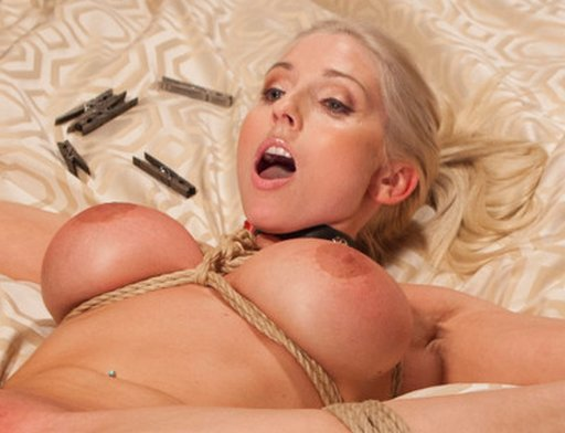 Christie Stevens tied up and about to get her nipples pinched severely